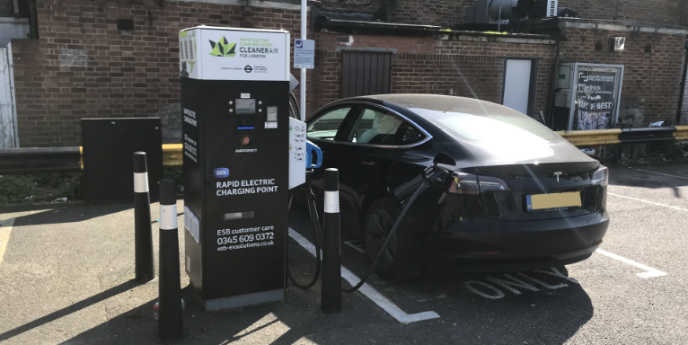 Car charging at ESB Energy Rapid Charge Point in London